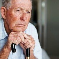 Depressed elderly man lost in thought