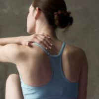 a woman with neck pain